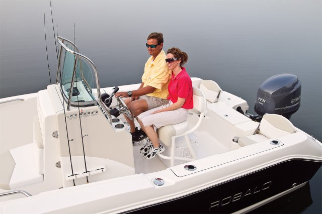 ... an open hull boat where the console of the boat is in the; A R180 Center ...